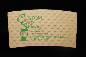Custom coffee cup sleeve in natural with green text - Custom Cup Sleeves Smyrna, TN