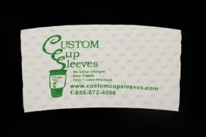 Custom coffee cup sleeve in white with green text - Custom Cup Sleeves Smyrna, TN