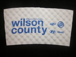 Wilson County Auto custom coffee cup sleeve on white with blue text - Custom Cup Sleeves Smyrna, TN