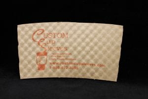 Custom coffee cup sleeve in natural with orange text - Custom Cup Sleeves Smyrna, TN
