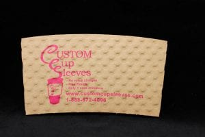 Custom coffee cup sleeve in natural with pink text - Custom Cup Sleeves Smyrna, TN