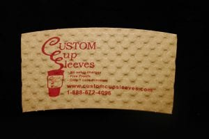 Custom coffee cup sleeve in natural with red text - Custom Cup Sleeves Smyrna, TN