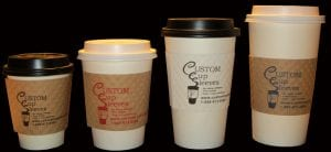 Four hot paper coffee cups with black and white lids - Custom Cup Sleeves Smyrna, TN