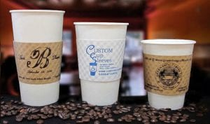 Three hot paper cups in three sizes with custom printed coffee cup sleeves - Custom Cup Sleeves Smyrna, TN